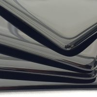 black coasters stacked fanned closeup