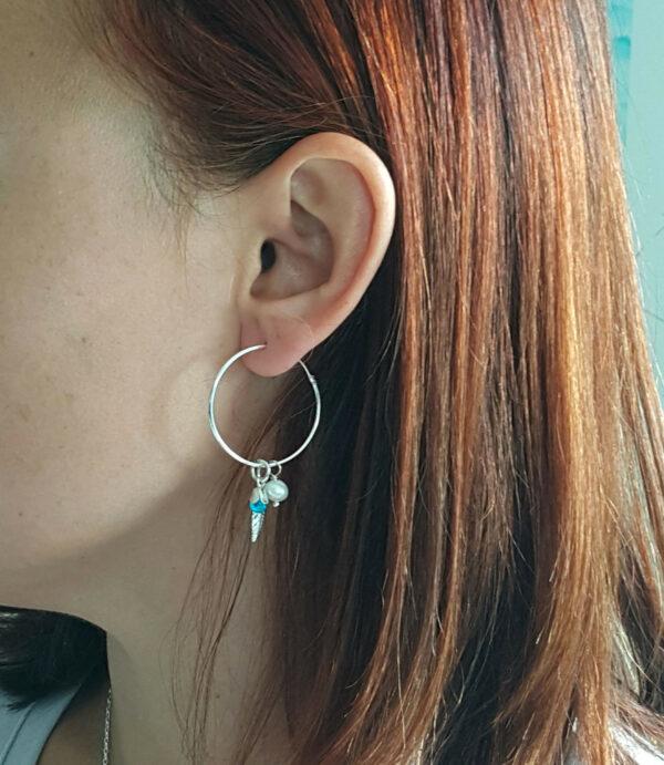large hoop earring being worn